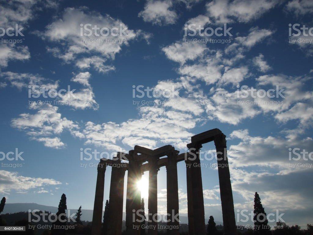 Sun behind the Temple of Zeus stock photo