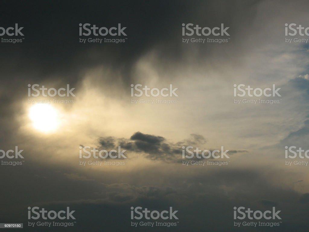 Sun between storm clouds stock photo
