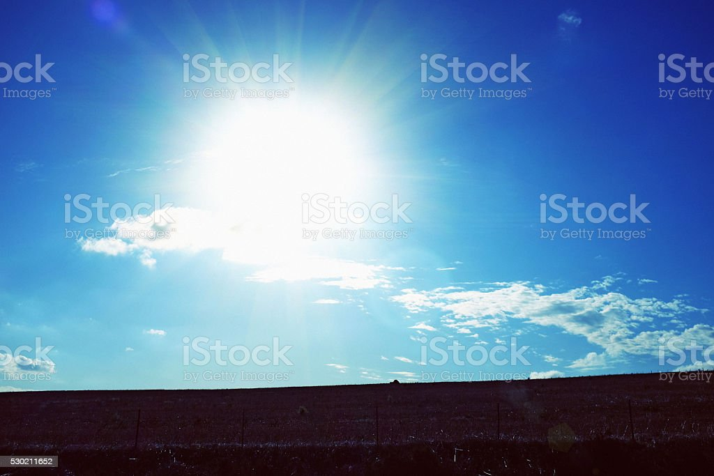 Sun blazing down on farmland stock photo