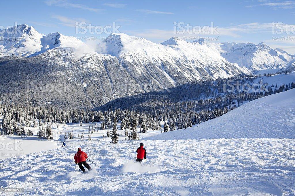 Sun Bowl and Skiers on Whistler Mountain stock photo