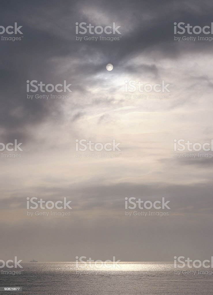 Sun breaking through clouds royalty-free stock photo