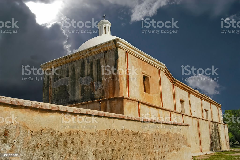 Sun Breaking Through Storm Clouds over Mission Tumac?cori stock photo