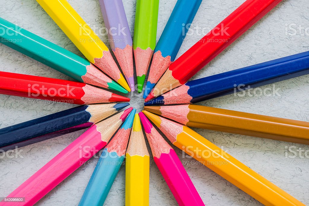 sun burst made of colorful pencils stock photo