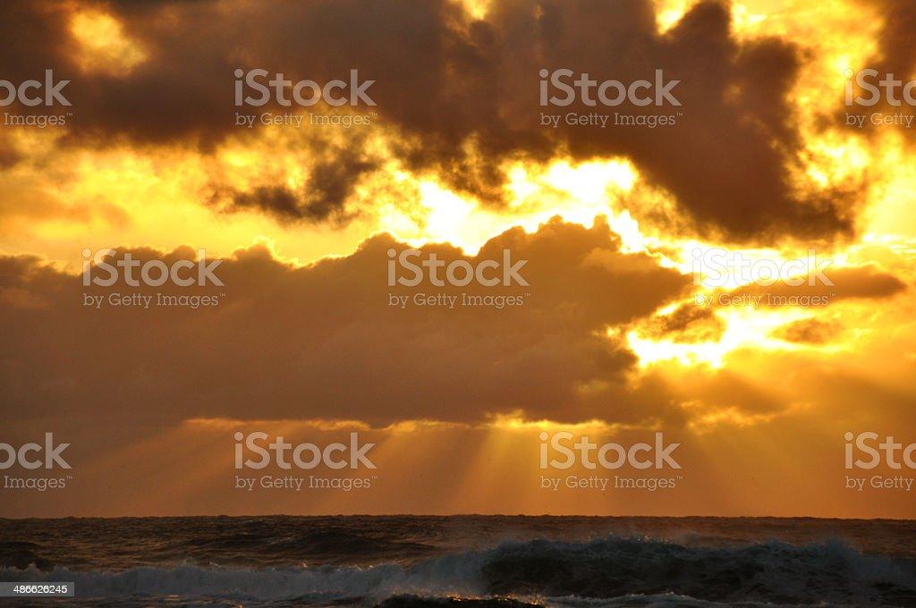Sun bursting through clouds royalty-free stock photo