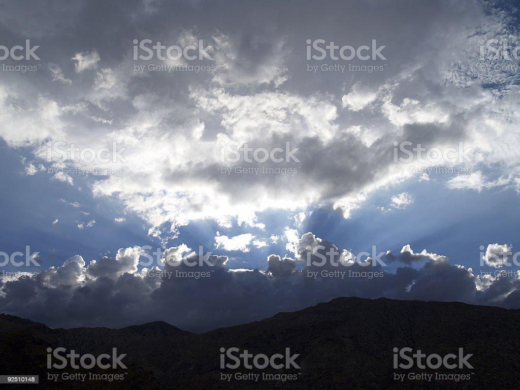 Sun Bursting Through Clouds stock photo