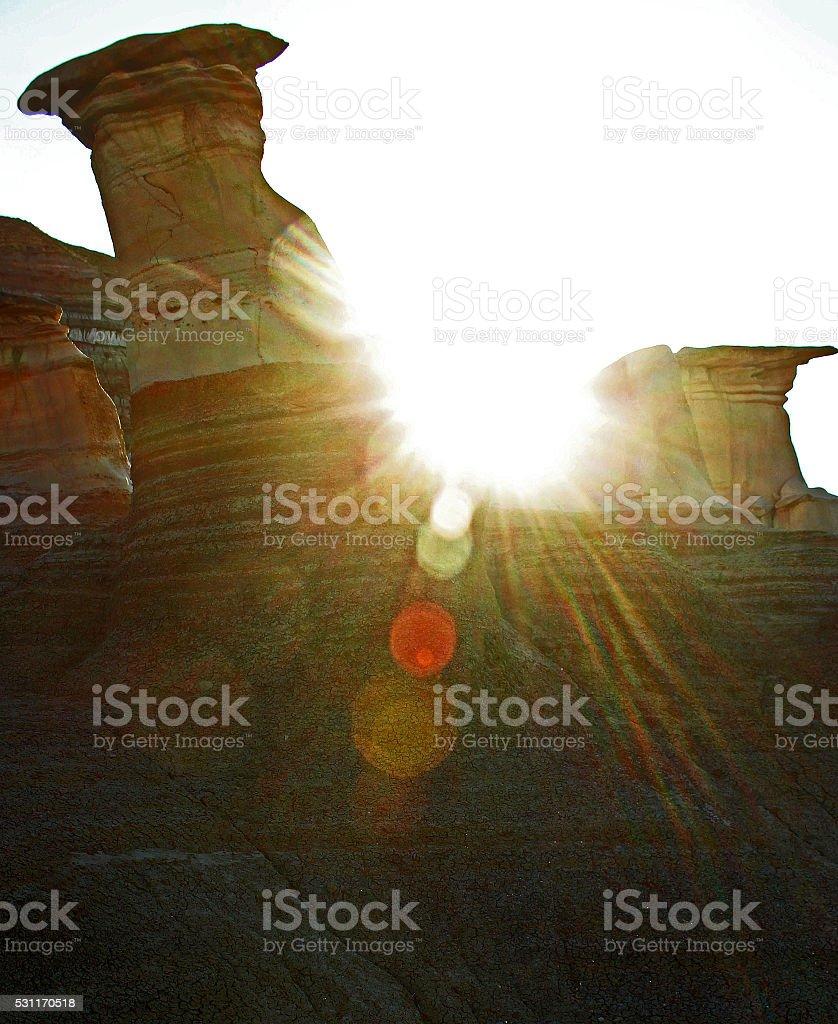 Sun Bursts Between Drumheller Hoodoos stock photo