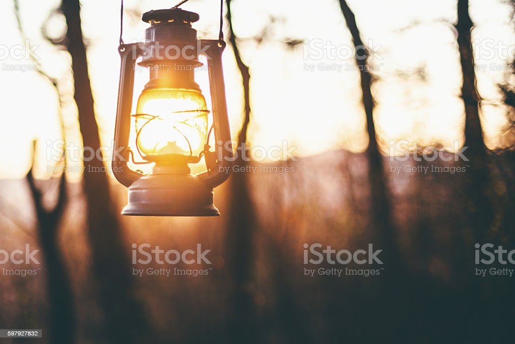 Sun captured in old lantern stock photo