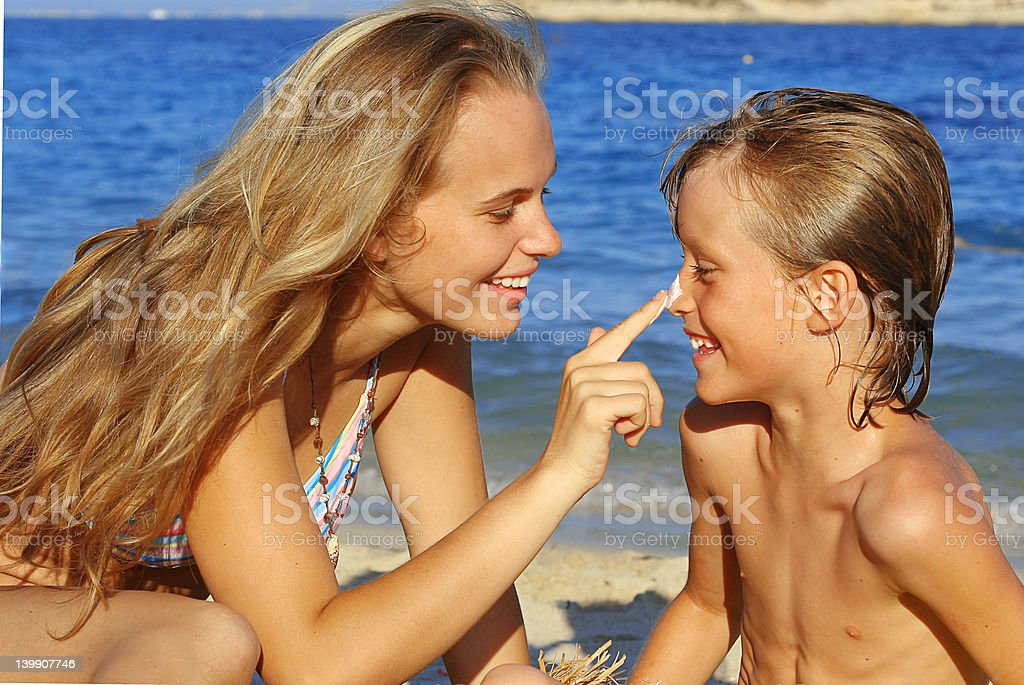 sun care(SEE below for more family and beach images) royalty-free stock photo
