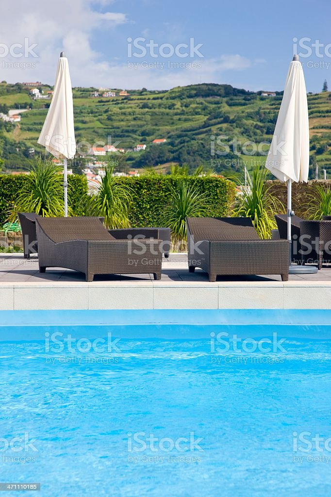 Sun chairs with white umbrella royalty-free stock photo
