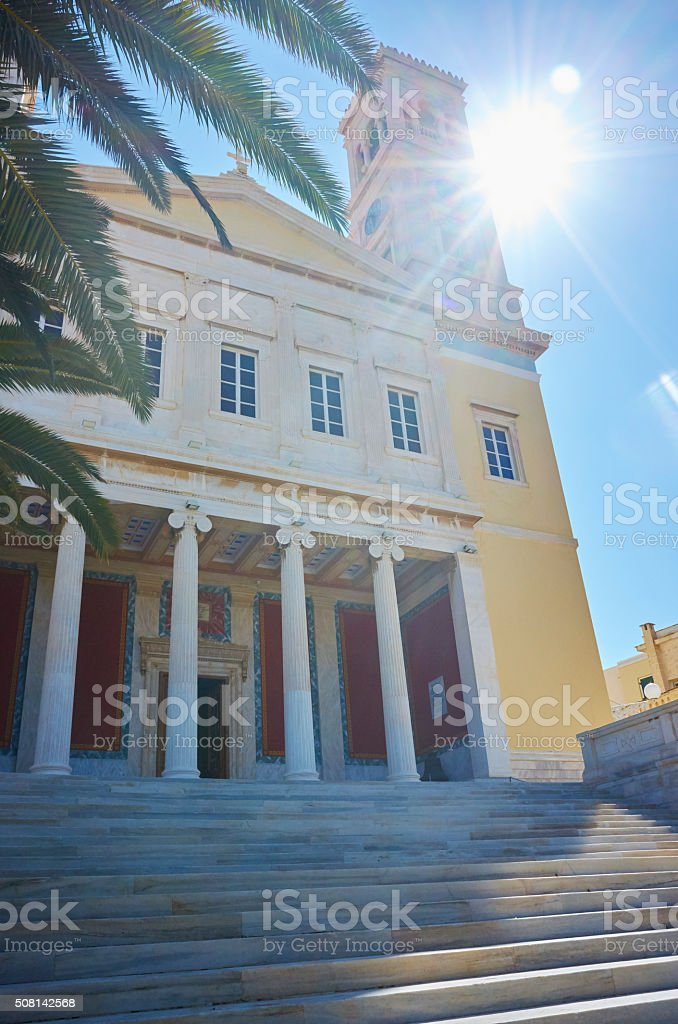 Sun, church and palm tree on Tinos stock photo