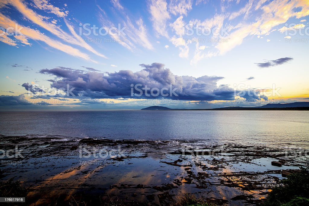 Sun clouds over ocean rock pool royalty-free stock photo