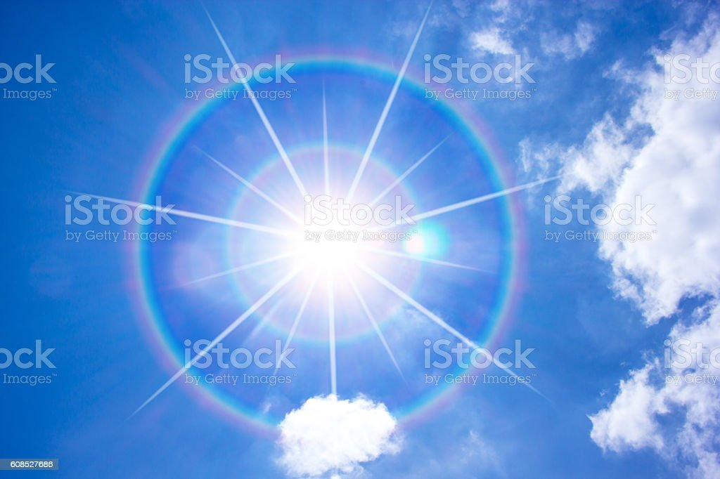 Sun corona on blue sky. stock photo
