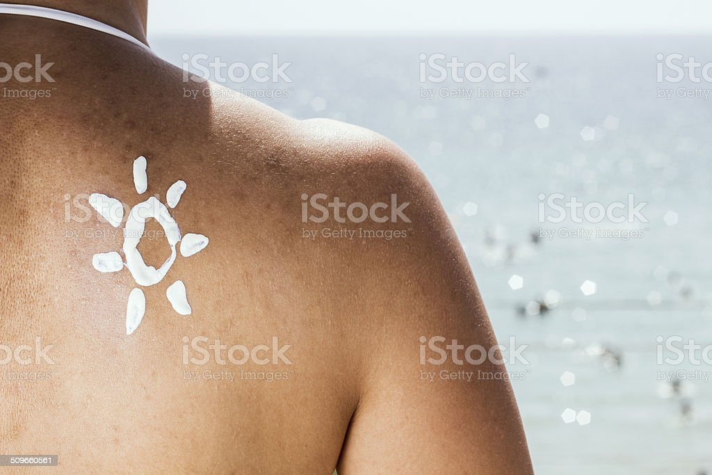 Sun Cream on a Woman's Shoulder stock photo