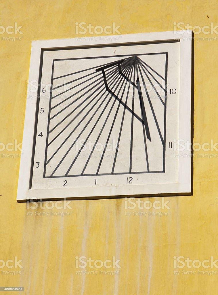 Sun Dial On Yellow Wall stock photo