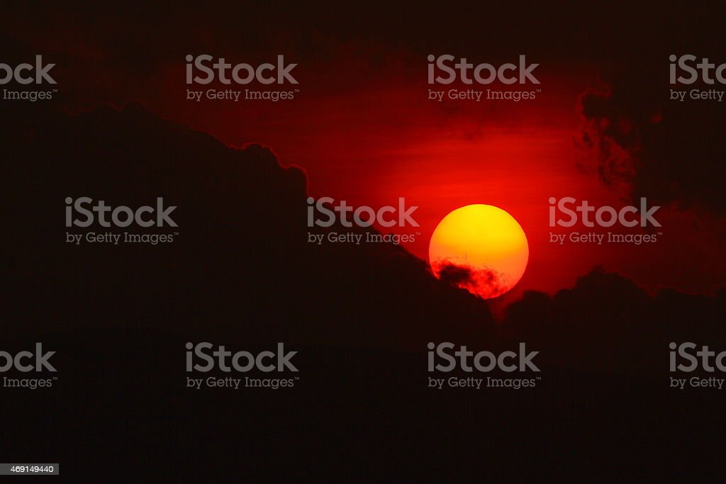Sun Down Clouds and Mountains stock photo