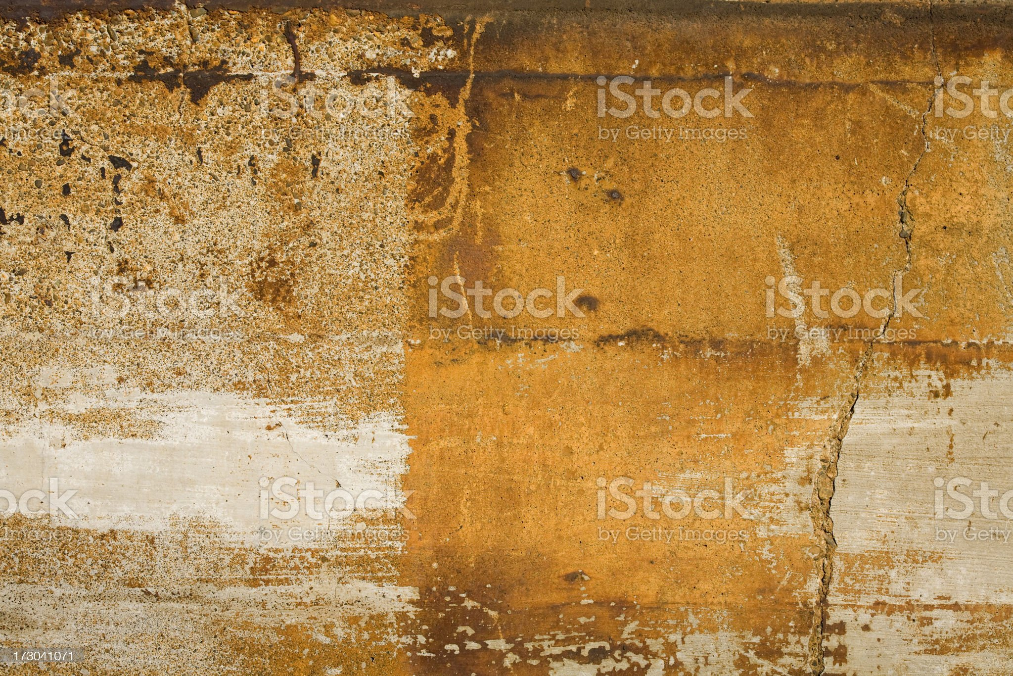 Sun drenched rusty concrete wall royalty-free stock photo