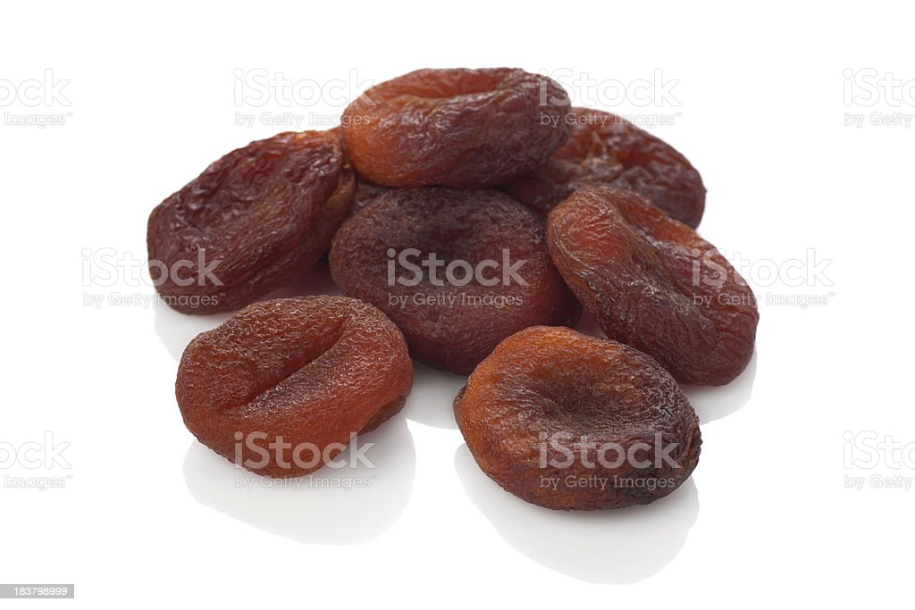 Sun dried apricots on the white background.Natural fruit. stock photo