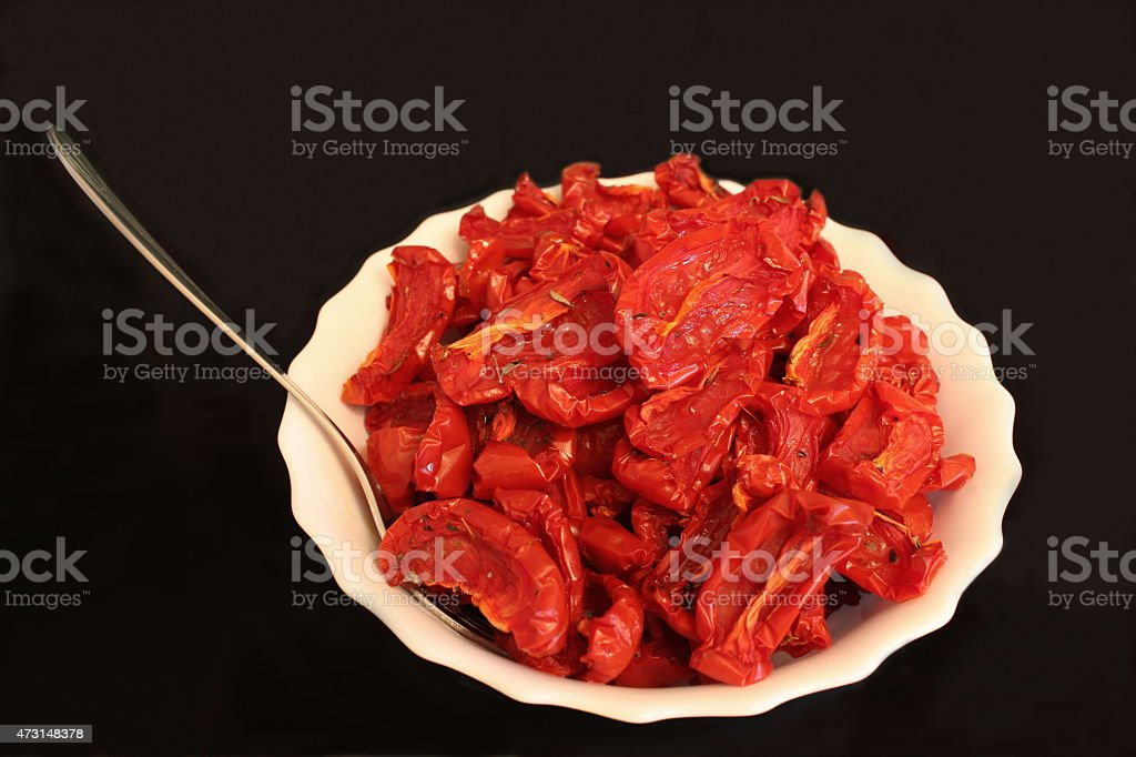 Sun dried tomatoes on a plate stock photo