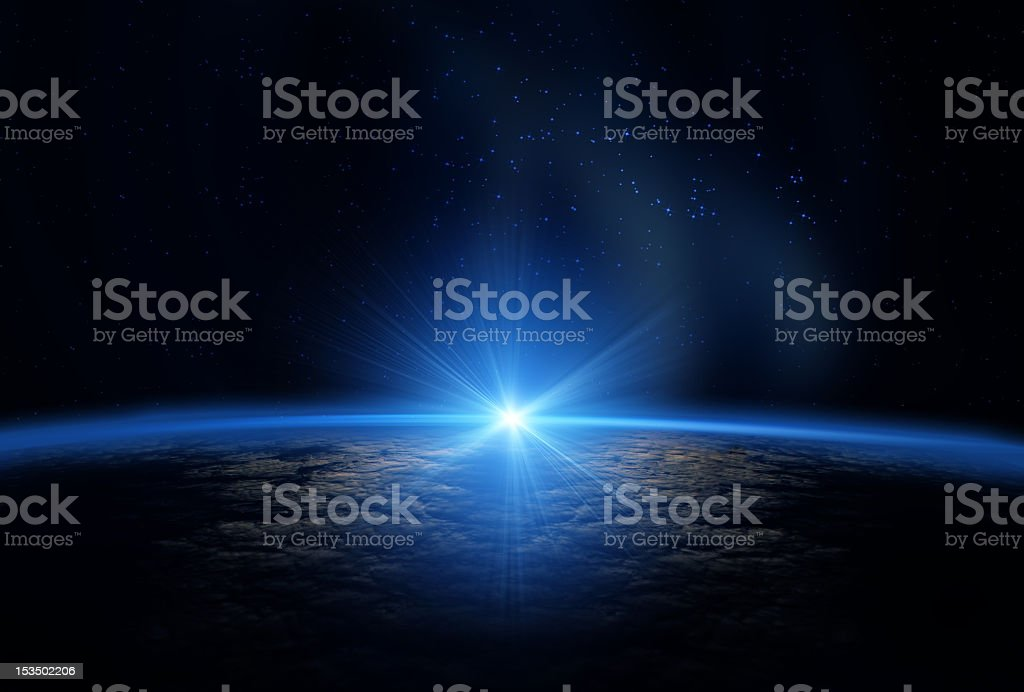 Sun emerging over the curvature of the earth from space  stock photo