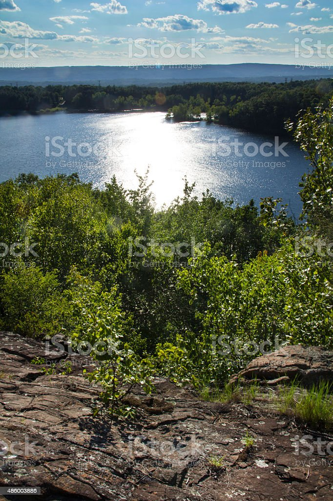 Sun glare on Wassel Reservoir from Ragged Mountain, Berlin, Conn stock photo