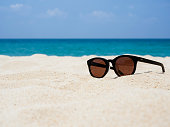 Sun glasses on Beach Summer Holiday Travelling background