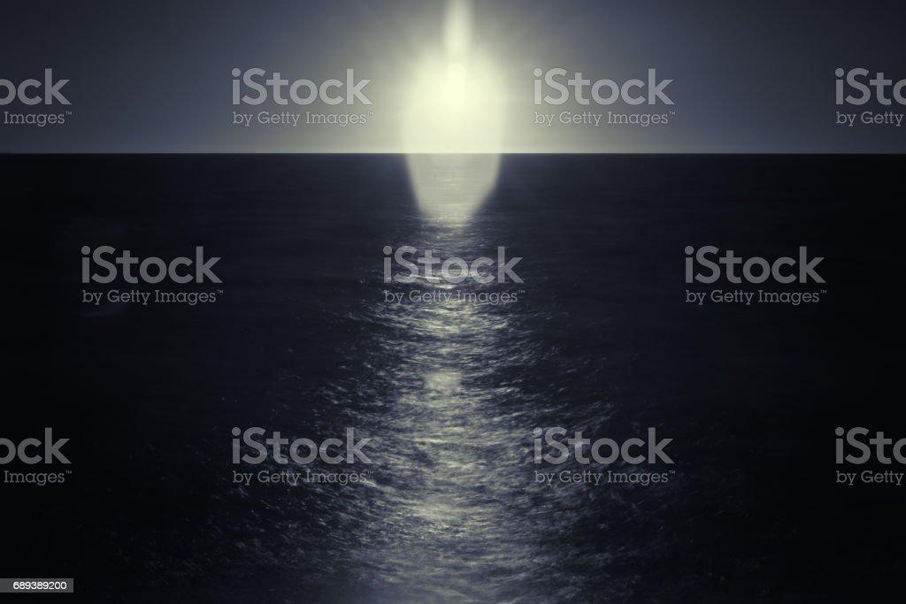 sun gleaming on the sea stock photo