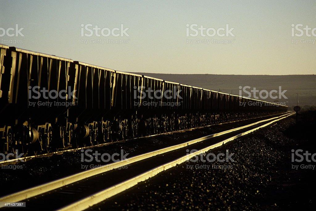 Sun glinting on iron ore train stock photo