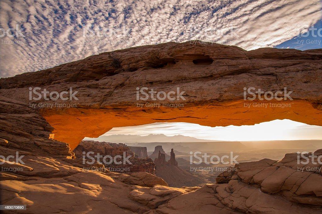 Sun glows through Mesa Arch in Canyonlands stock photo