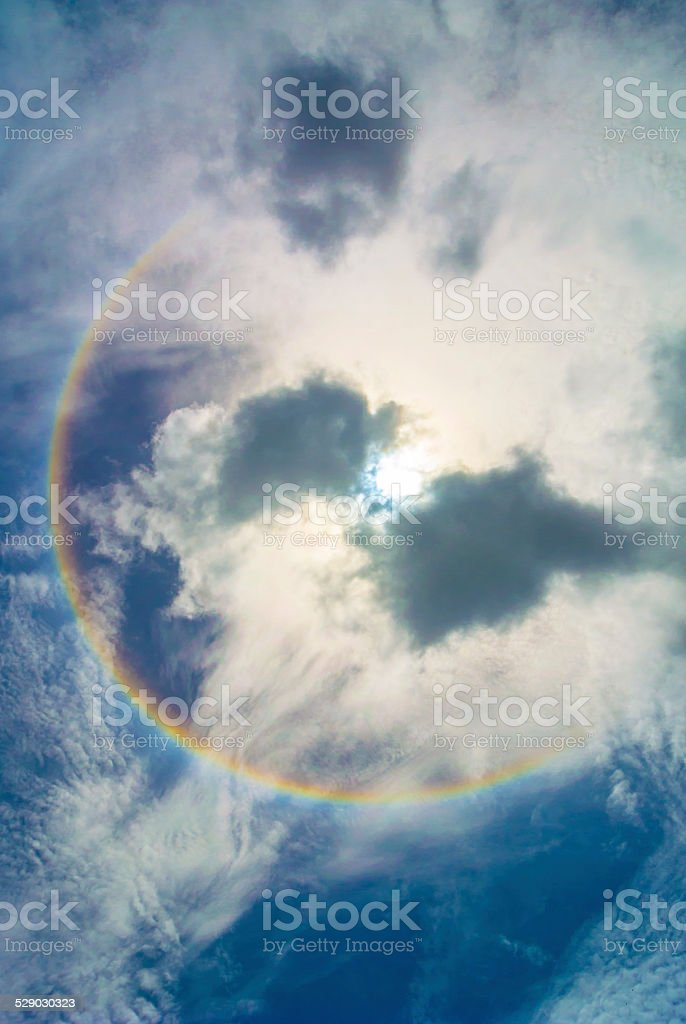 Sun halo and clouds. stock photo