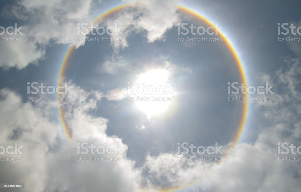 sun halo occurring due to ice crystal   in thai stock photo