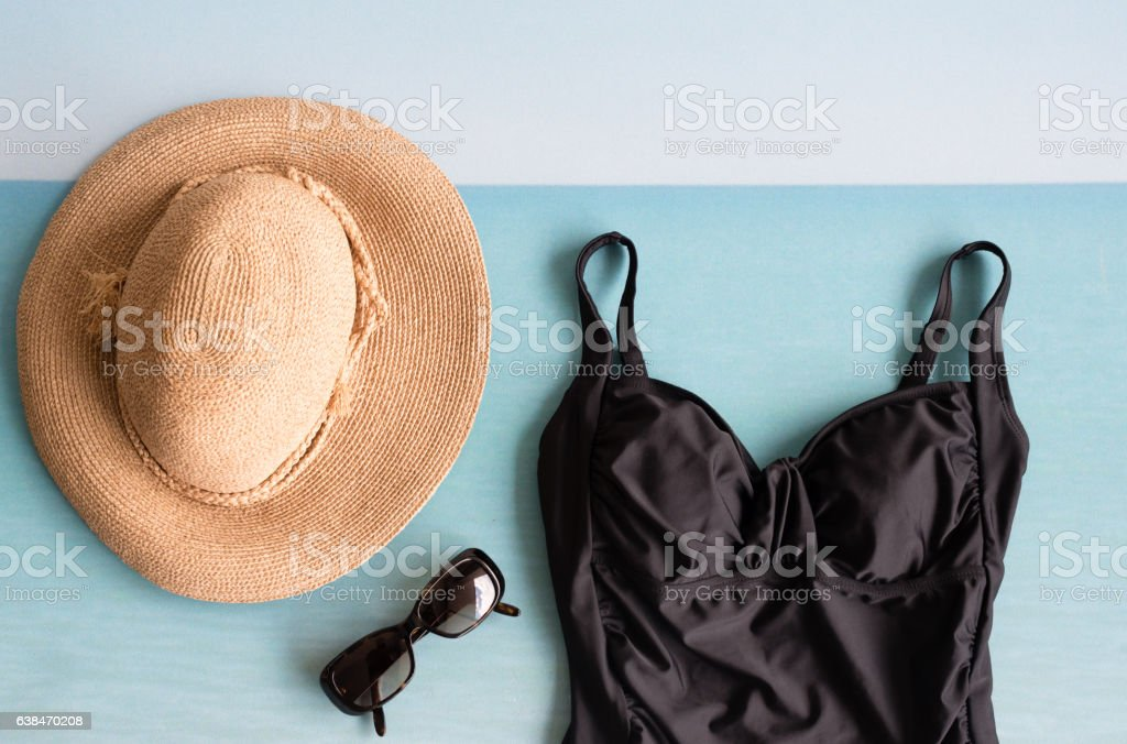Sun hat, sunglasses and swimsuit from above stock photo