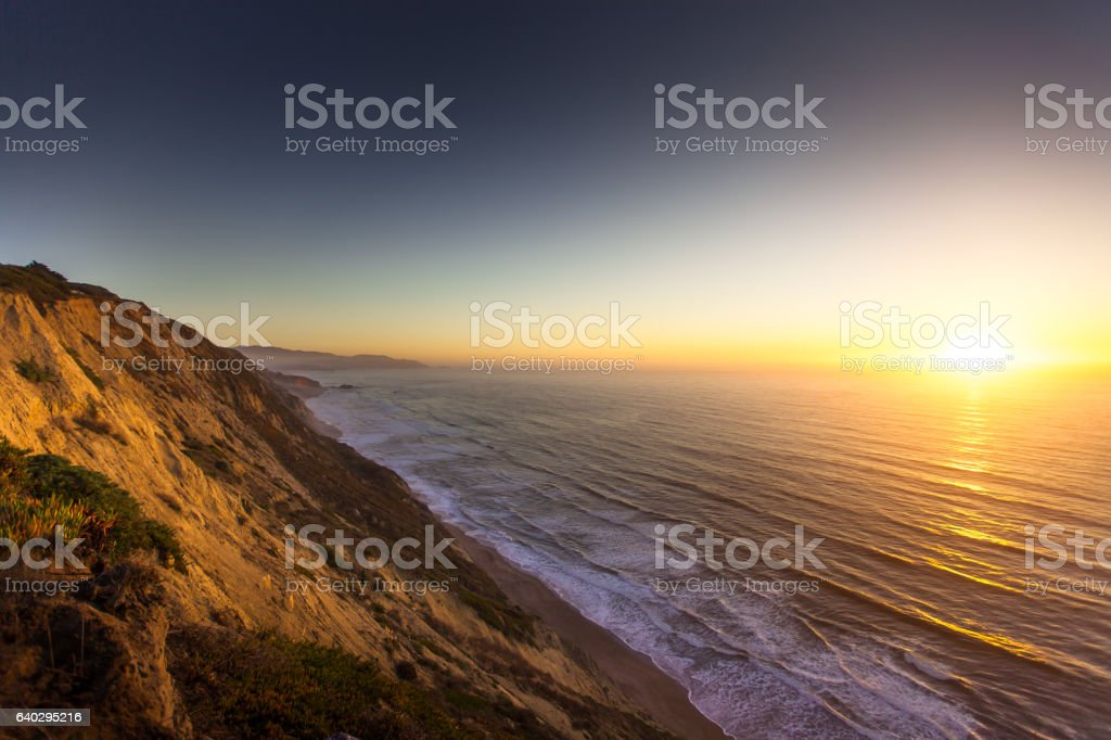 Sun Hitting Pacific Ocean from California Coast stock photo