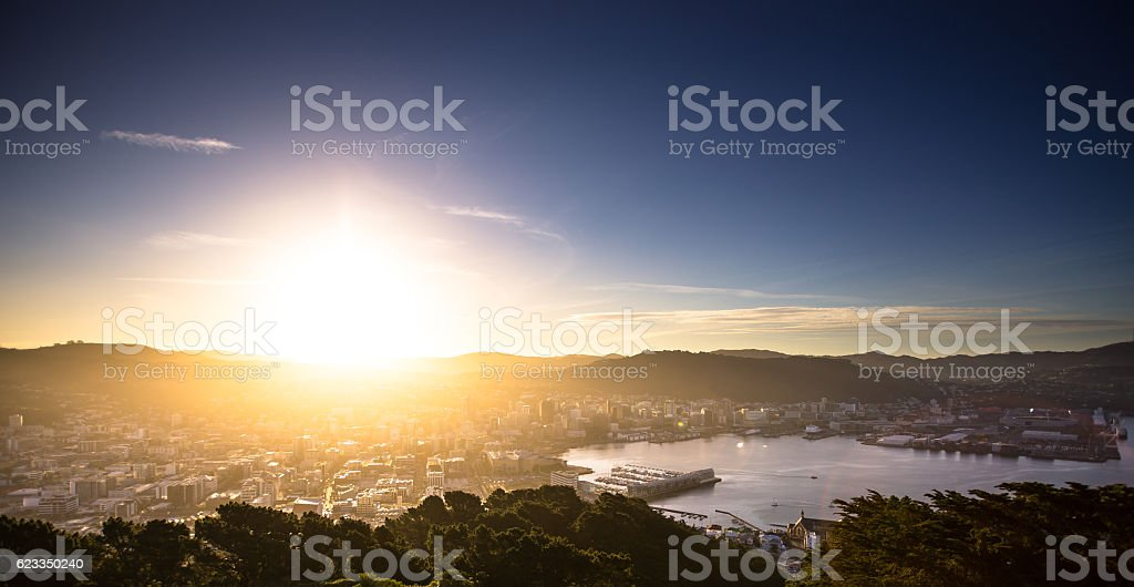 Sun Hitting the Horizon Over Wellington Harbour stock photo