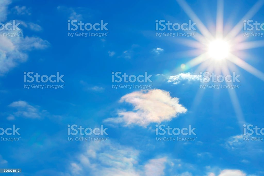 Sun in a blue sky stock photo