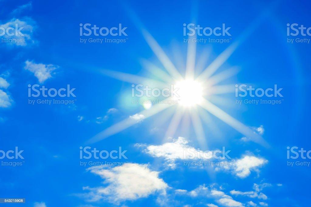 Sun in a blue sky stock photo