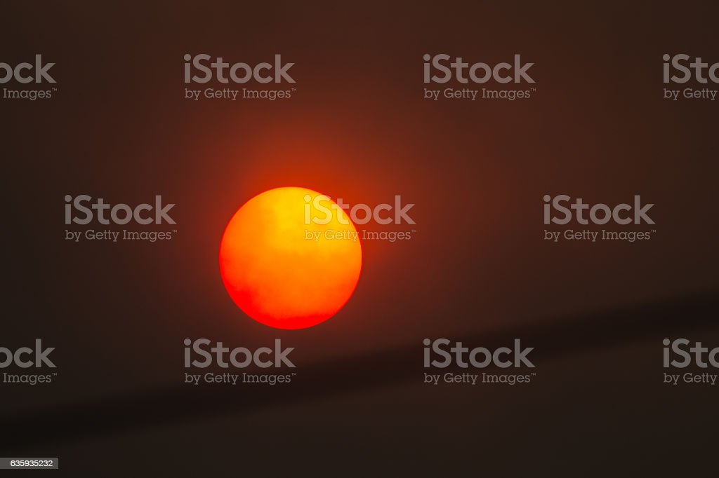 Sun in a forest fire with smoke stock photo