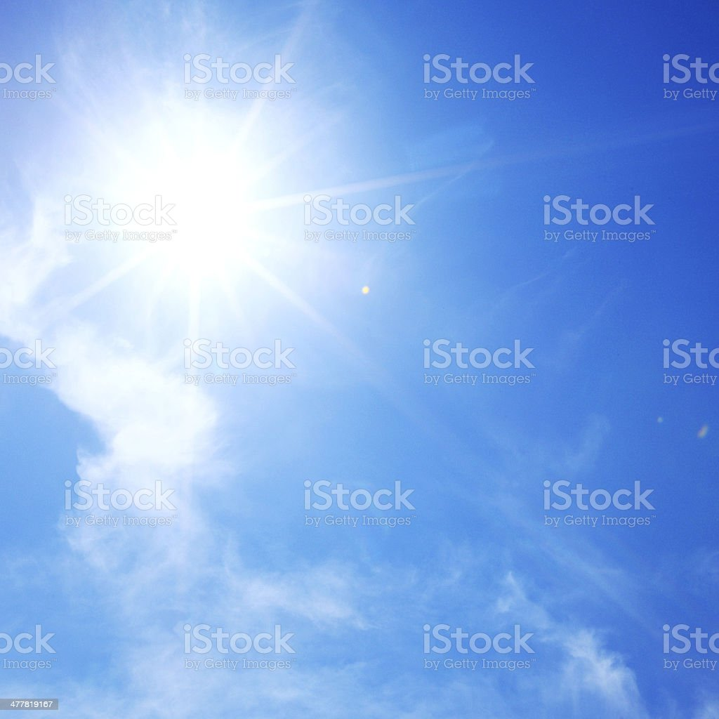 sun in blue sky stock photo