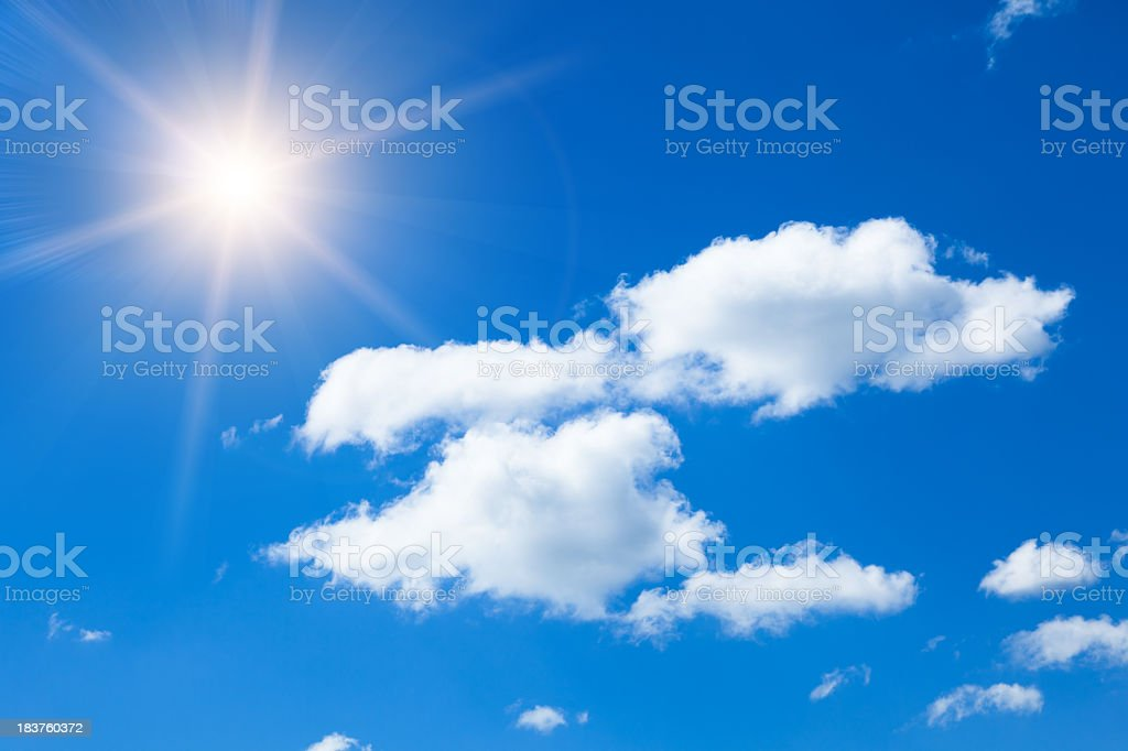 Sun in blue sky with clouds. stock photo