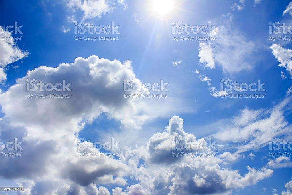Sun in bright blue sky. stock photo