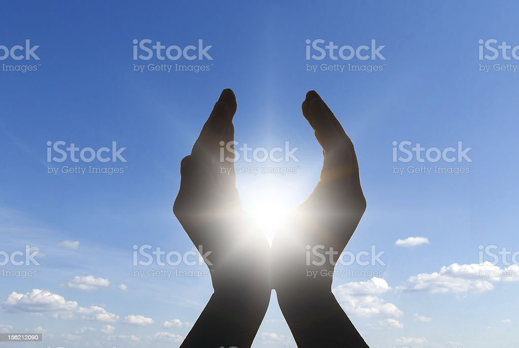 sun in hands stock photo