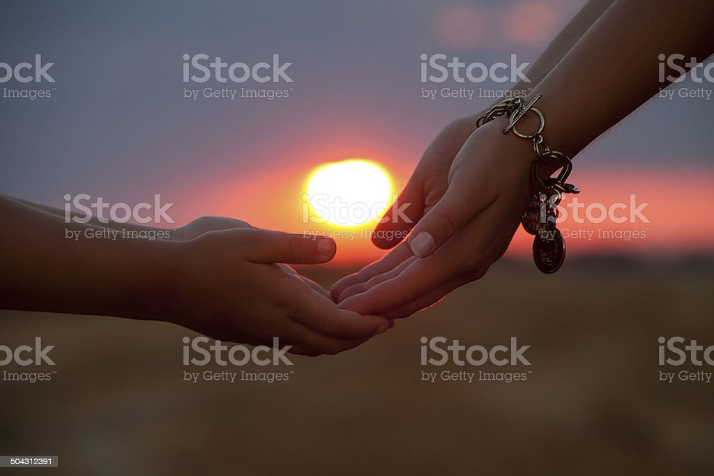 Sun in hands stock photo
