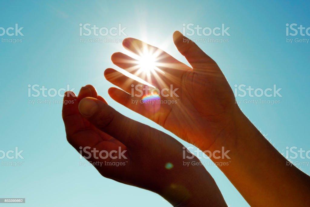Sun in my hands (50 megapixels) stock photo