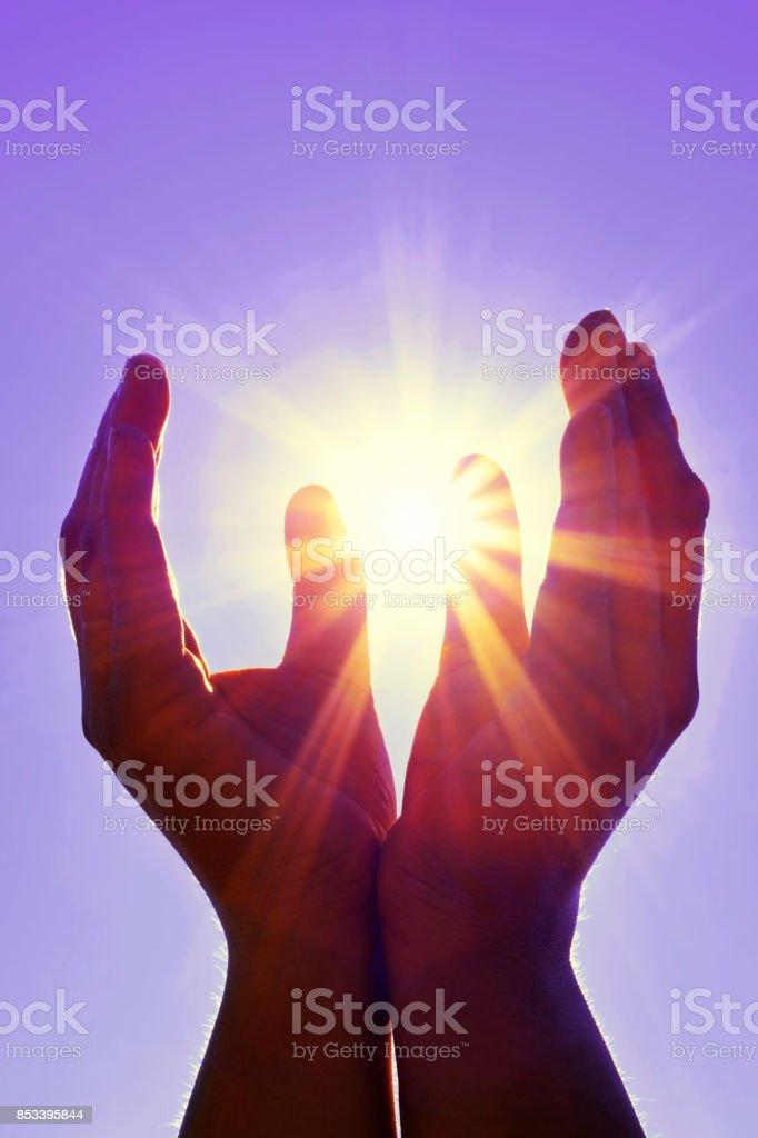 Sun in my hands stock photo