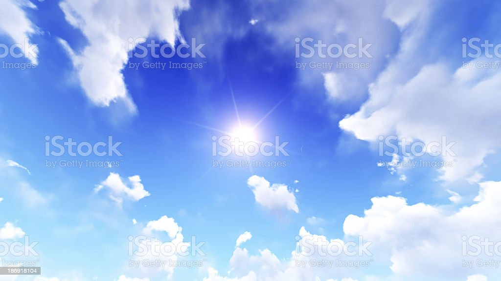 Sun in the blue cloudy sky royalty-free stock photo