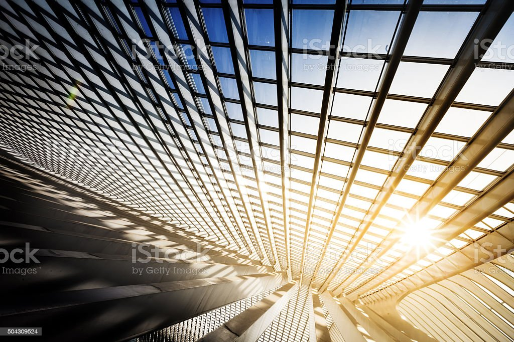 Sun Is Breaking Through Windows In A Modern Building stock photo