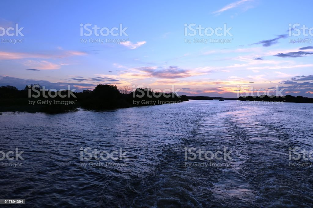 Sun is going under at the Sambesi River, Zambia Africa stock photo