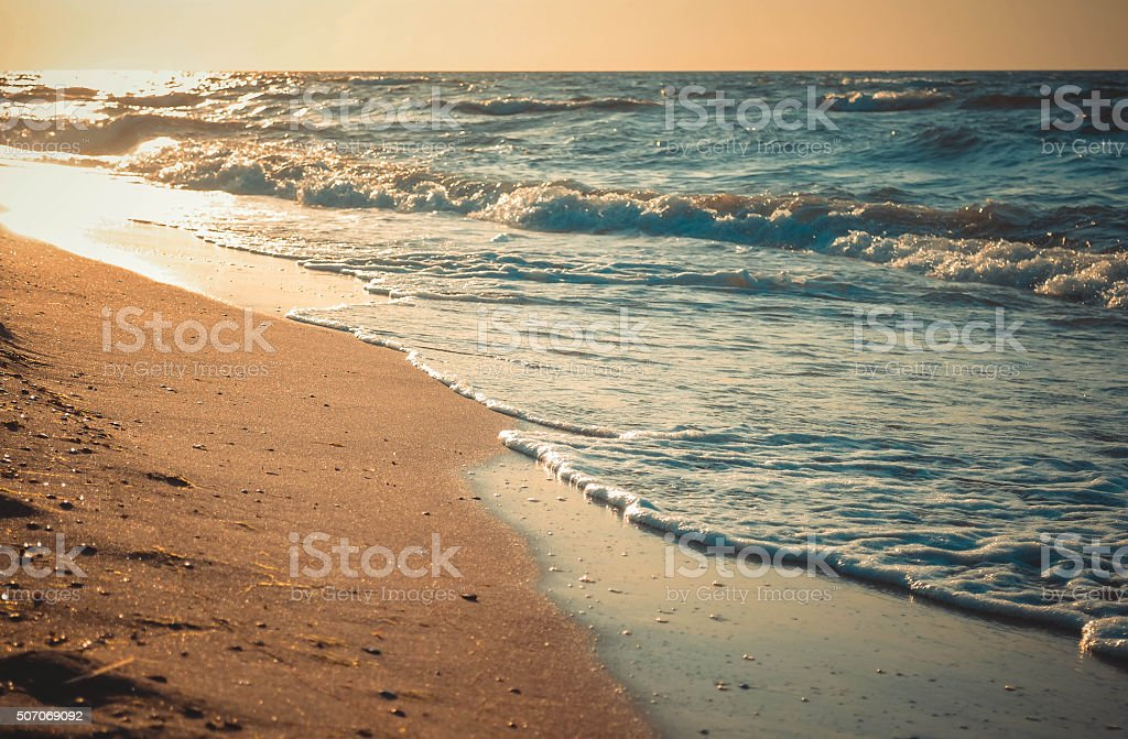 sun is reflected  sandy beach, close-up stock photo