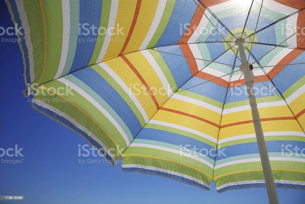 Sun is shining through a colorful umbrella royalty-free stock photo