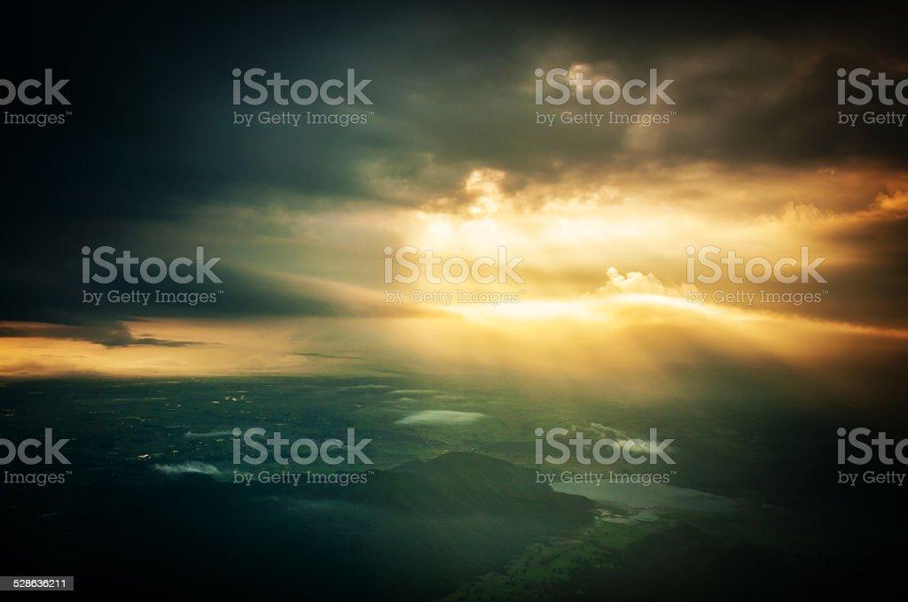sun light and dark cloudy sky stock photo