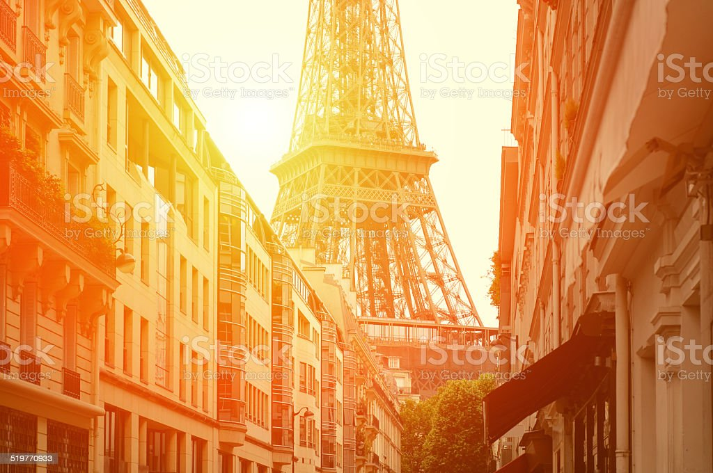 Sun light on the street with view the Eiffel Tower stock photo